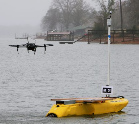Image of the drone in flight over the jet-powered kayak